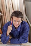 Guy holding a pencil Stock Photos