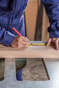 Carpenter marking a plank Stock Photos