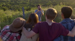 Friends Put Their Arms Around Each Other, Pose For Photos (Slow Motion) Stock Footage