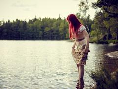 Stock Photo of Attractive woman on the lake
