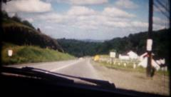 2317 - road trip filmed through windshield of automobile-vintage film home movie Stock Footage