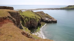 Worm`s Head Rhossili The Gower peninsula Wales UK PAN Stock Footage
