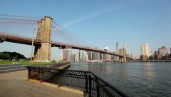 Brooklyn Bridge Spans The East River In New York On A Clear Sunny Day HD - stock footage