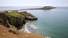 Worms Head Rhossili The Gower peninsula Wales UK small tidal island Stock Footage