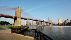 Boat Sailing Under Brooklyn Bridge On The Water In New York City On Sunny Day HD - stock footage