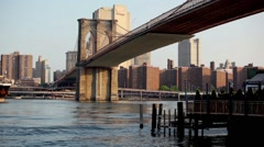 A Large Ship Approaches Brooklyn Bridge On The East River Of NYC HD Stock Footage