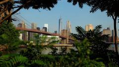 Thru The Trees Brooklyn Bridge And Manhattan Skyline Can Be Seen In NYC HD - stock footage