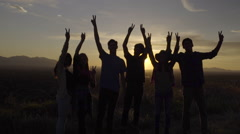 Group Of Teens Hold Up Peace Signs At Sunset Then Walk Away (Slow Motion) - stock footage