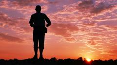 Man  tourist , prayer,with  raised hands  at sunrise, sunset time. 4K 3840x2160 Stock Footage