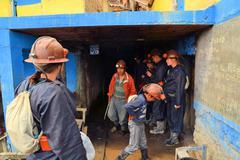 Tourists enter Cerror Rico silver mine in Potosi, Bolivia - stock photo
