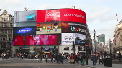 Piccadilly Circus junction crowded by people in London Stock Footage