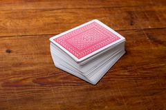 deck of cards on wooden table - stock photo