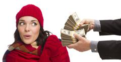 Mixed Race Young Woman Being Handed Thousands of Dollars Stock Photos