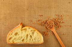 Canvas with slice of bread and ripe grains - stock photo