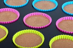 Preparation of chocolate muffins - stock photo