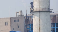Factory chimney emitting gas in air, polluting environment, editorial footage. Stock Footage