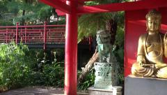 4k Tropical ZEN garden panning with Buddha statue - stock footage