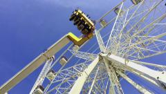The rides at the amusement Park. Review wheel. Stock Footage