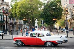 People and traffic at the famous El Prado Boulevard in Old Havana Stock Photos