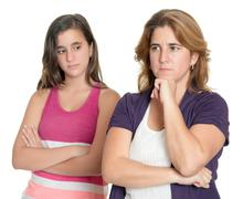 Mother and her teenage daughter sad and angry at each other Stock Photos