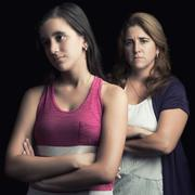 Teenage girl and her mother sad and angry Stock Photos