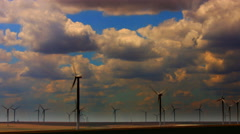 Sunset and Wind Turbines, Time Lapse, Zoom In Stock Footage