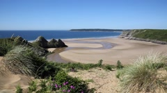 The Gower Peninsula Swansea Wales uk Three Cliffs Bay Stock Footage