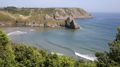Three Cliffs Bay south coast the Gower Peninsula Swansea Wales uk Stock Footage