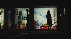 Sillouette of tourist next to China billboard 4K Stock Footage