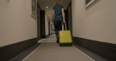 Woman Walking along the Hotel Passage with Trolley Bag Stock Footage