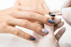 Master gets a new paint gray fingers on different - stock photo