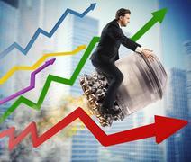 Urban businessman between stats Stock Photos