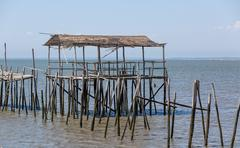 Very Old Dilapidated Pier in Fisherman Village - stock photo