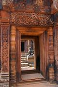 stone carving on red sandstone doorways - stock photo