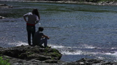 Silhouette Couple On River Banks Of Ottauquechee River Vermont Stock Footage