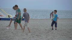 People, Children Are Running, Teenage Boys Playing Football at The Sandy Beach, - stock footage