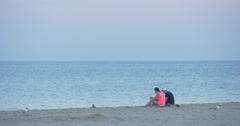 Couple, Man and Woman Have a Rest on The Seaside, Coastline, Sandy Beach, Stock Footage