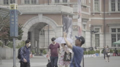 Walking people in front of Seoul train station Stock Footage