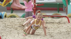 Stock Video Footage of Children Are Playing, Boy and Girl are Creeping by the Sand, Running at The