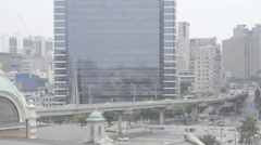 Car rides on the street at the building forest at the Seoul train station Stock Footage