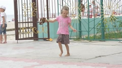 Children, Kids Are Playing at The Playground, Girl in Pink T-Shirt is Swaying, Stock Footage