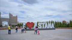 """I love Astana - text in front of the shopping center """"Khan Shatyr"""" Stock Footage"""
