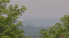 Smog and pollution cover Hamilton Ontario on hot summer day - stock footage
