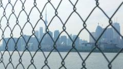 Toronto Skyline Through Chain Link Rack Focus Stock Footage