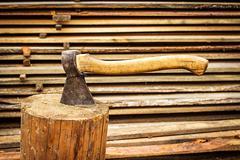 Old  axe in stump Stock Photos