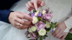 Wedding bouquet at bride's hands Stock Footage