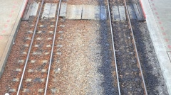 trains approaching to station platform - stock footage
