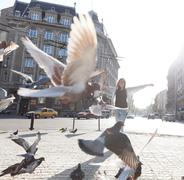 Young daydream girl feeling free in down town city. Stock Photos