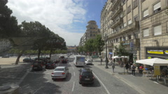 Driving on Aliados Avenue in Porto in a sunny day Stock Footage