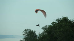 Paramotor flying in the air Stock Footage